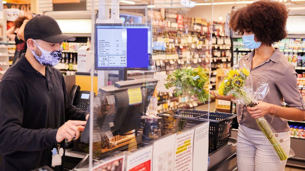 Masked people in supermarket