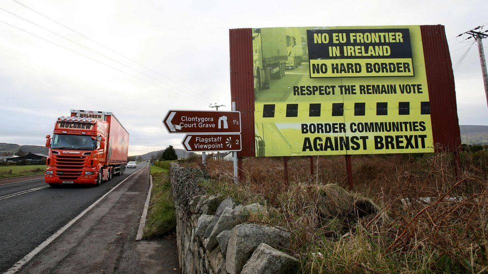 File image of traffic crossing the border into Northern Ireland from the Irish Republic past a Brexit Border poster on December 1, 2017