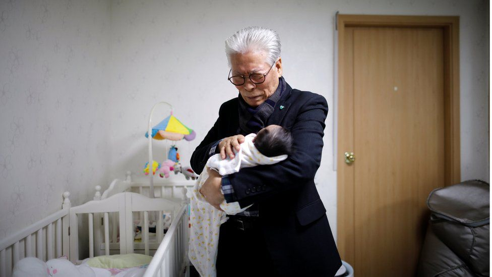 Lee Jong-rak, a senior pastor of Jusarang Community Church, prays for a baby who was left in the baby box in Seoul, 18 December 2018