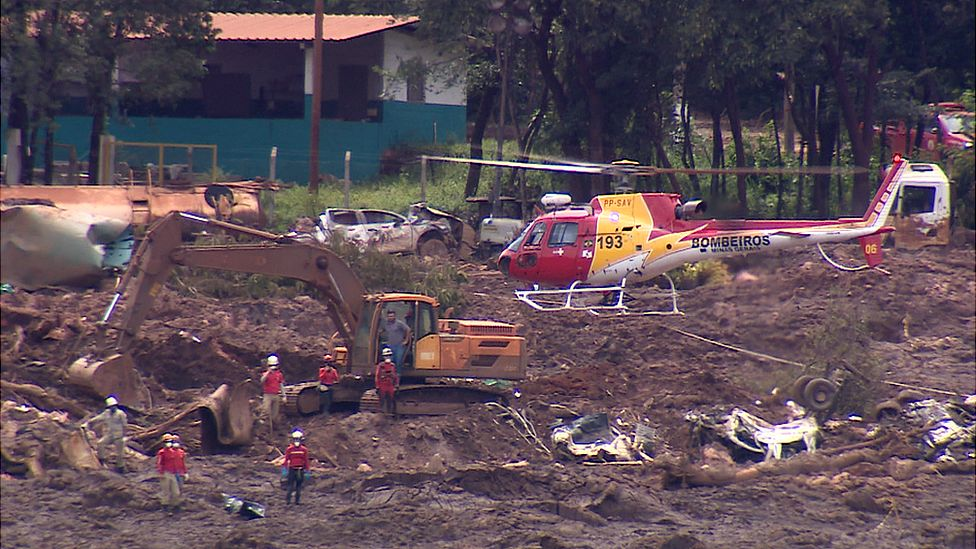Helicopter hovers over mud slide in Brazil