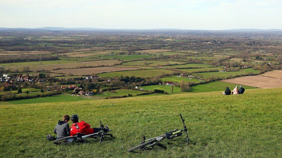 Members of the public enjoy some fresh air at Devil's Dyke, a National Trust beauty area, on March 21