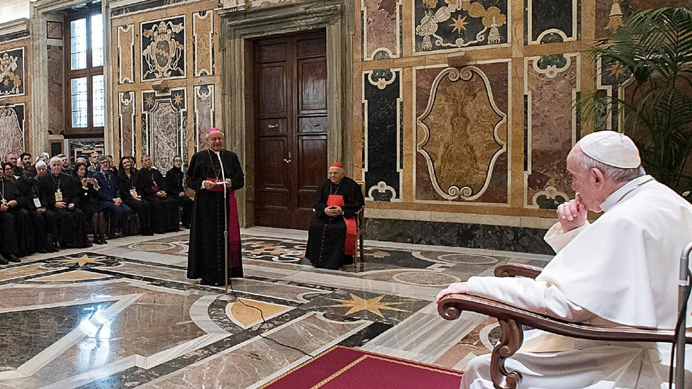 Pope Francis listens to Archbishop Paglia