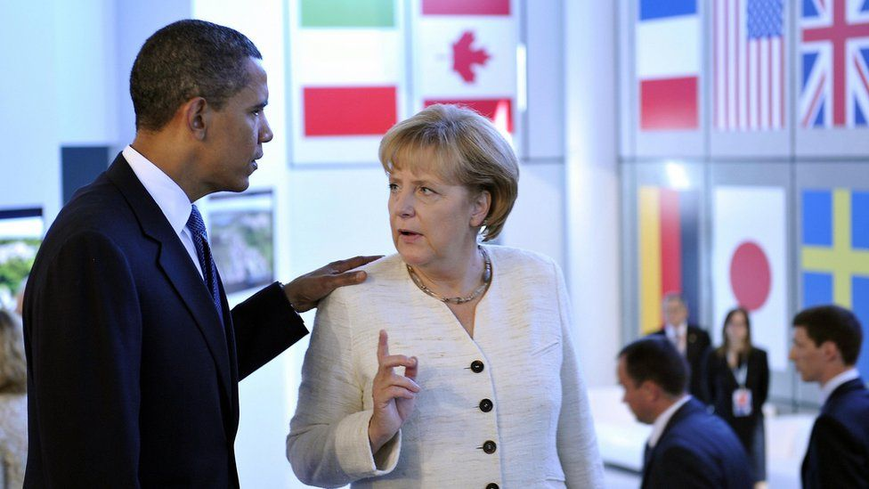 Former US President Barack Obama and Chancellor Merkel at G8 in Italy, July 2009