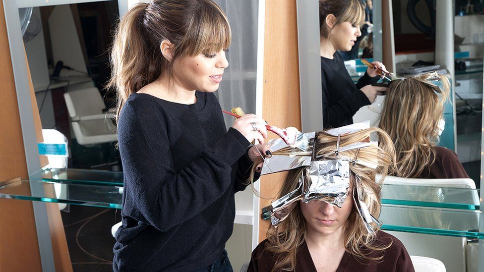 Rita Hazan colours a woman's hair