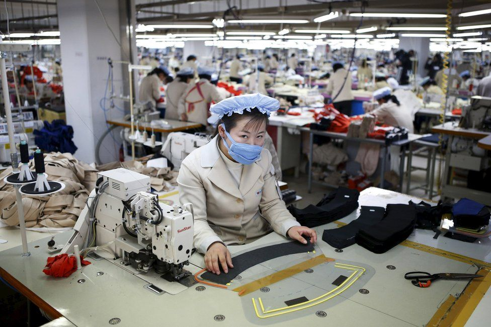 A North Korean employee works in a factory of a South Korean company at the Joint Industrial Park in Kaesong industrial zone, a few miles inside North Korea from the heavily fortified border in this 19 December 2013 file photo.