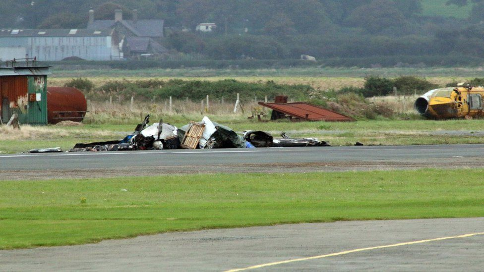 Wreckage of light aircraft on runway at Caernarfon Airport