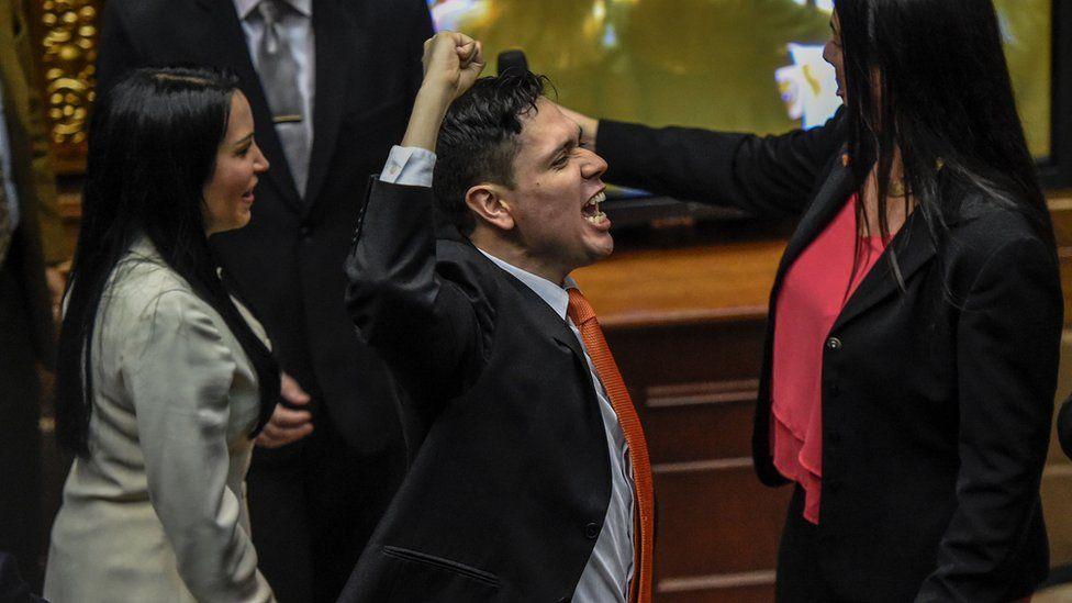 Rosmit Mantilla gestures after receiving his credentials as a legislator in Venezuela's National Assembly in November 2016