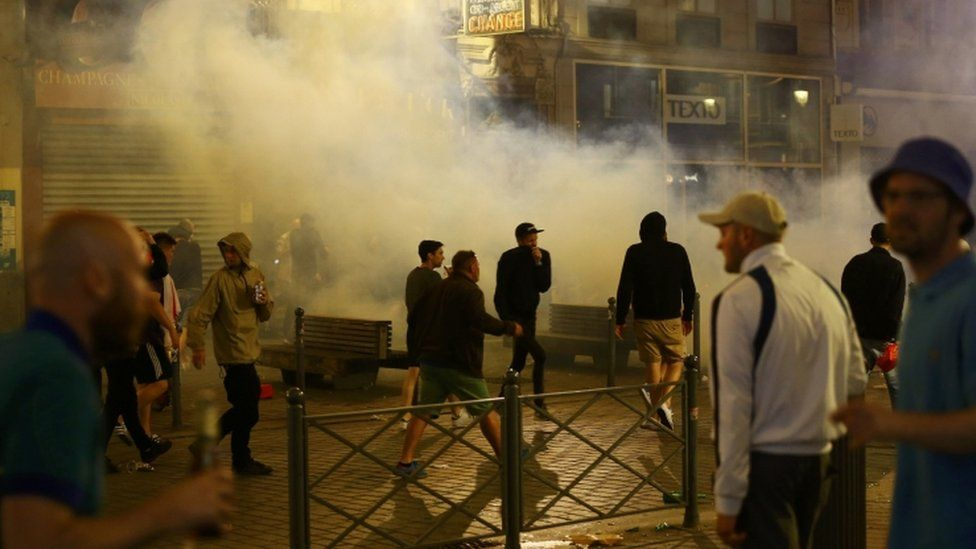 England fans running through tear gas in Lille, France, 15 June