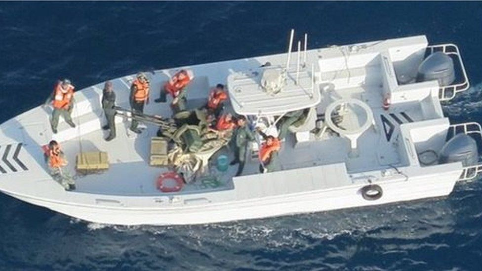 Pentagon-supplied picture purporting to show an Iranian Revolutionary Guards Corps Navy vessel whose crew removed an unexploded limpet mine from a Japanese tanker, 17 June 2019