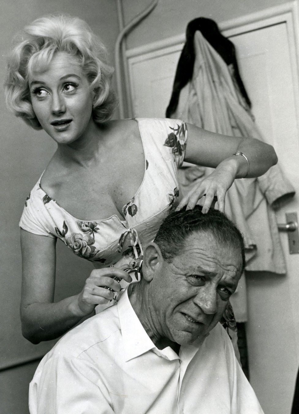 Liz Fraser taking scissors to the hair of Carry On co-star Sid James