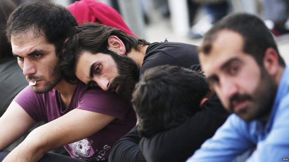 Relatives wait outside a morgue in Ankara, 11 October