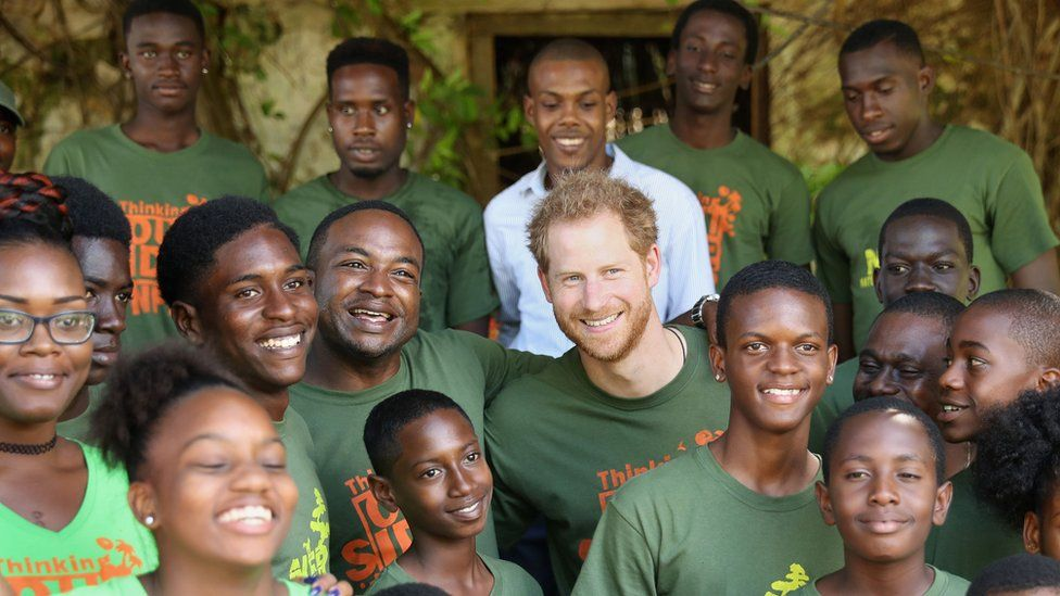 Prince Harry with volunteers whilst on tour in the Caribbean