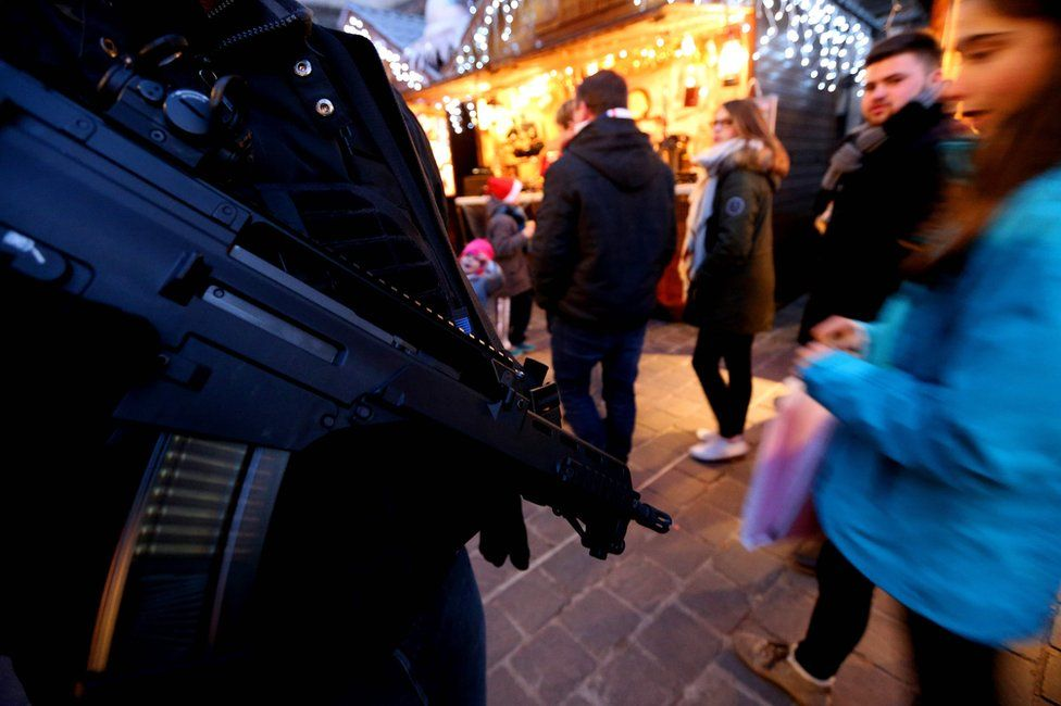 A French police officer patrols at the Christmas market in Reims, 20 December