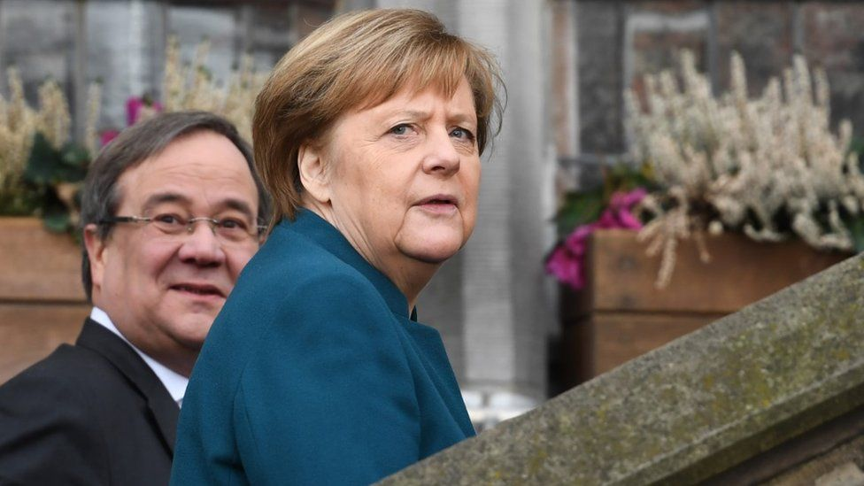 German Chancellor Angela Merkel (R) and the State Premier of North Rhine-Westphalia Armin Laschet arrive to attend the signature ceremony of a French-German friendship treaty, on January 22, 2019