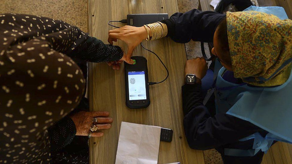 A fingerprint is read at a polling station