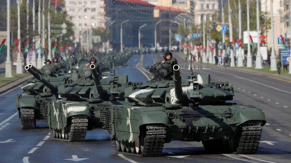 Belarusian servicemen drive tanks along the street before a rehearsal for the Victory Day parade on 8 May