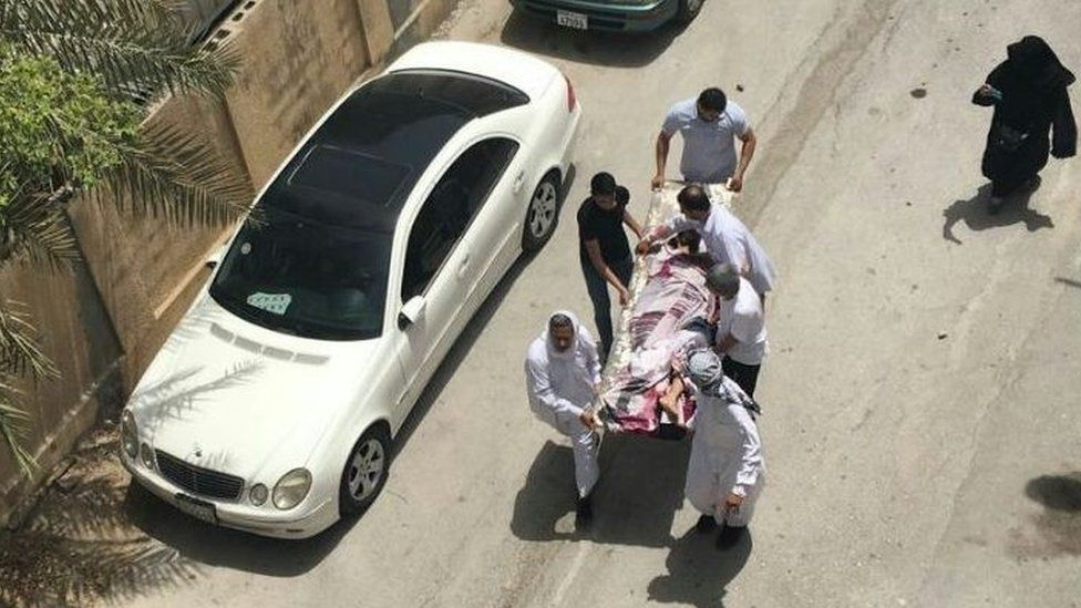 Photograph showing what activists say is an injured protester being carried on a stretcher after a police raid on a sit-in in Diraz on 23 May 2017