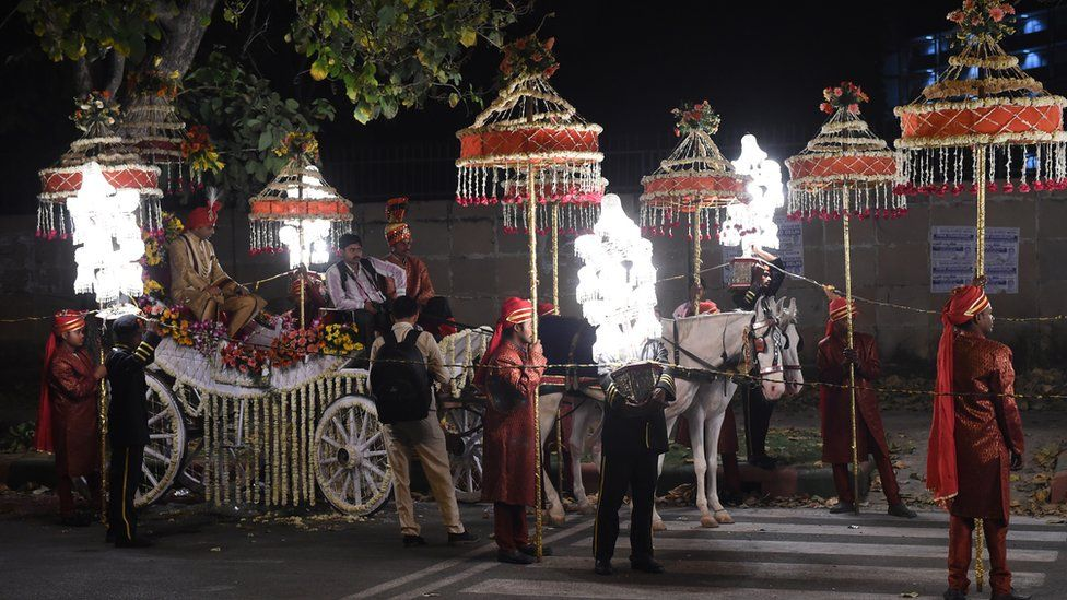 A groom sits on a horse cart during a wedding procession in New Delhi on April 21, 2015.