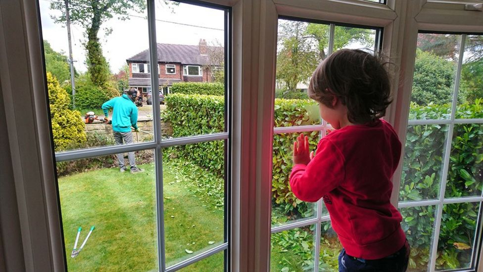 Boy looking out of a window