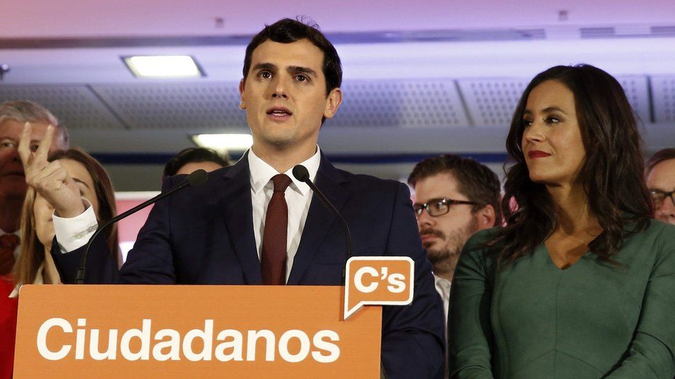 Leader and candidate of Ciudadanos (Citizens) Party Albert Rivera (L) celebrates with his supporters the results of the general elections in Madrid