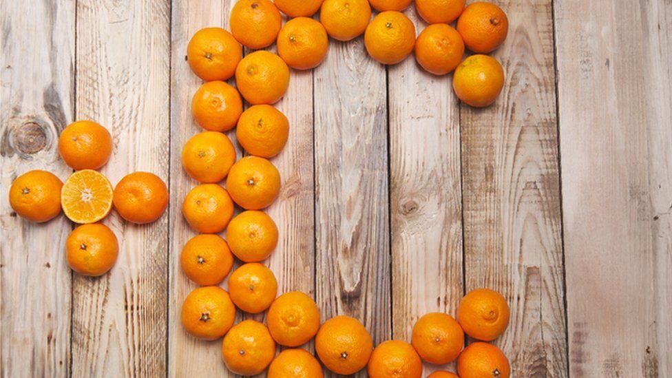 oranges spelling out vitamin C