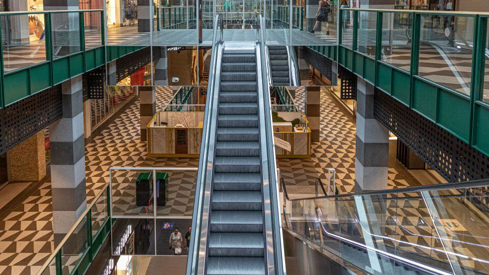 Empty escalators and shopping floors at a shopping mall on March 29, 2020 in Melbourne, Australia.