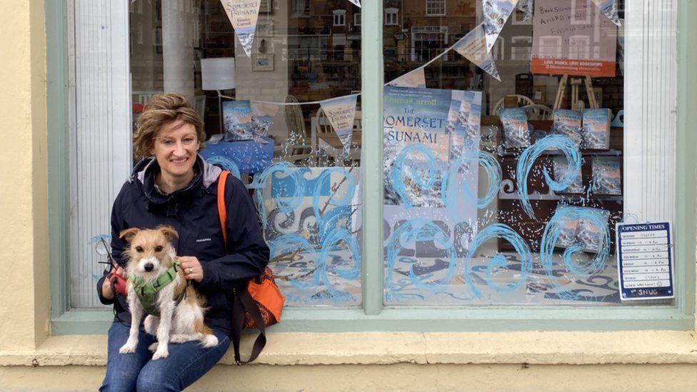 Emma outside bookshop