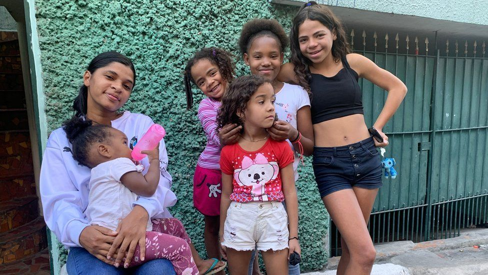 Joyce - Guilherme's neighbour - surrounded by her children