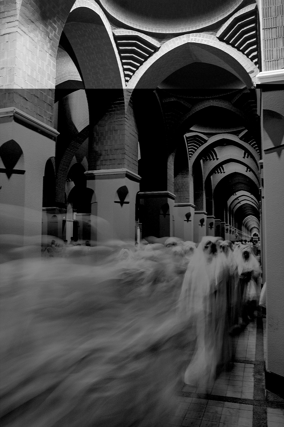 A long exposure photo of women walking down a corridor