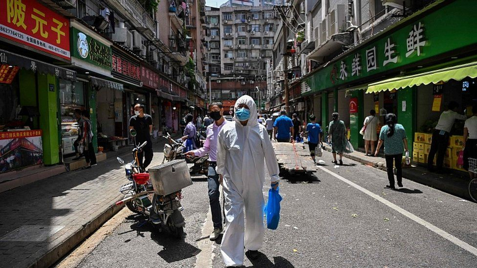 Street in Wuhan with person in protective clothing