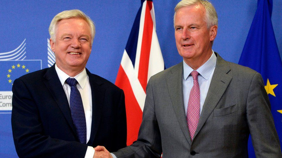 British Secretary of State for Exiting the European Union (Brexit Minister) David Davis (L) shakes hands with European Union Chief Negotiator in charge of Brexit negotiations with Britain Michel Barnier