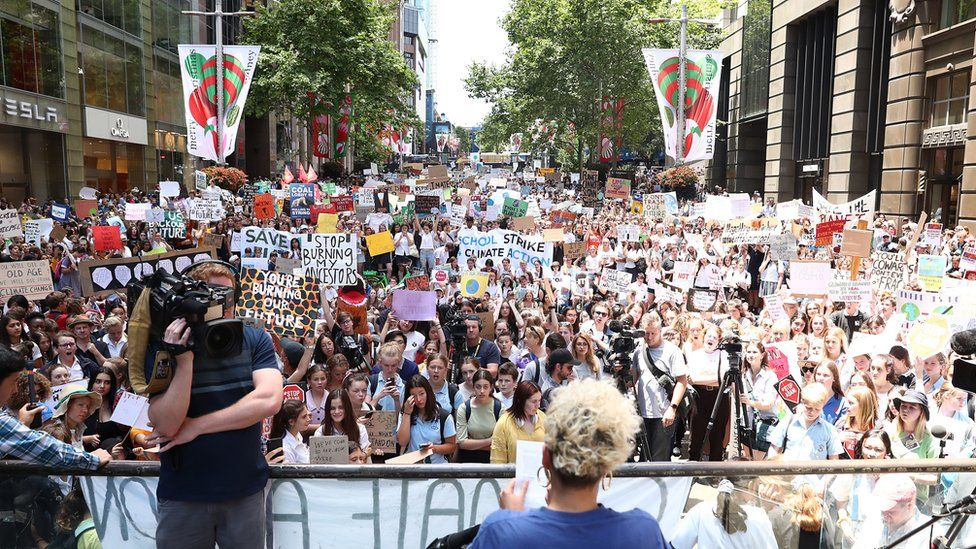 A crowd of student protesters fill up a city square in Melbourne