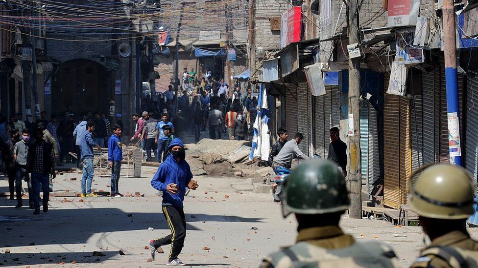 Kashmiri demonstrators clash with police during a protest against a government proposal to create exclusive settlements for Kashmiri Hindus in Srinagar on April 10, 2015.