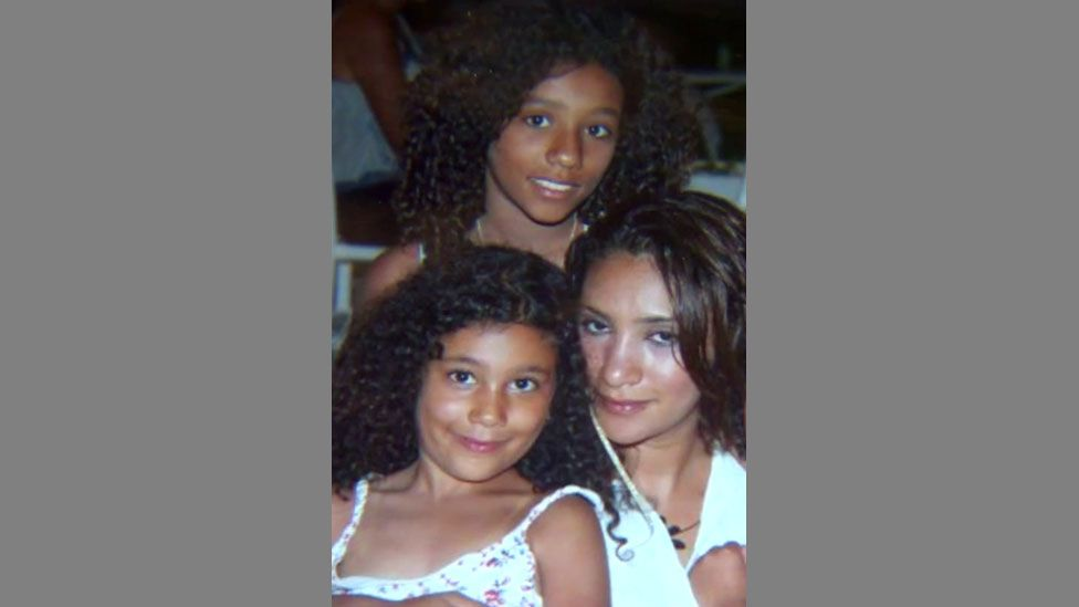 Mina Dich with her daughters, Safaa (in front) and Rizlaine
