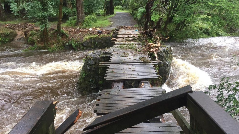An old bridge in Tollymore Forest Park which has been destroyed by flooding from the Shimna River in NI
