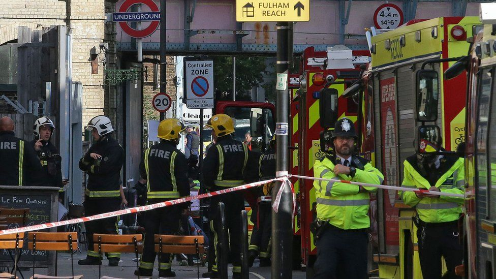 Members of the emergency services work outside Parsons Green underground tube station in west London