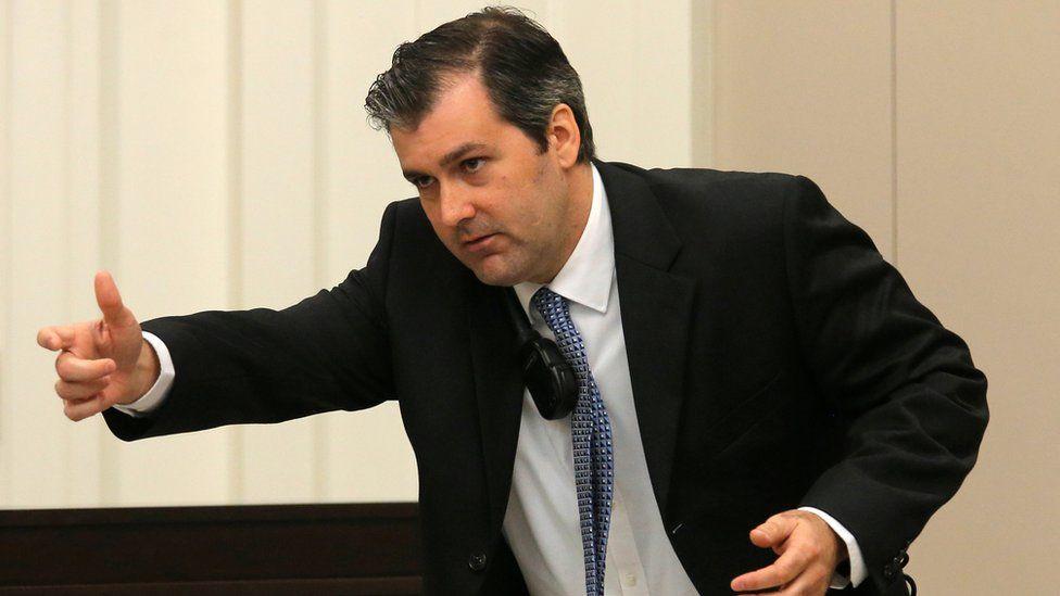 Former North Charleston police officer Michael Slager gestures as he testifies in his murder trial