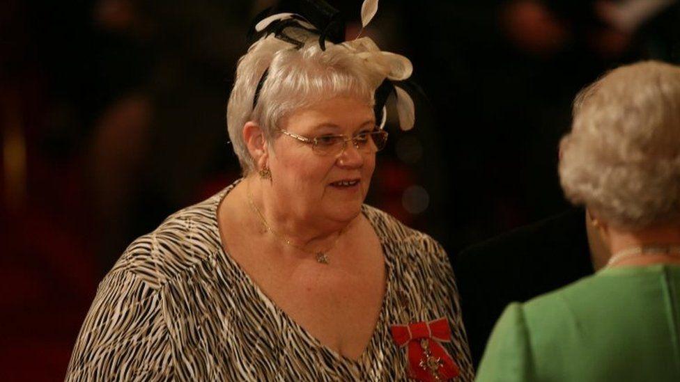 Penelope Jones as she receives her MBE from Queen Elizabeth II at Buckingham Palace in 2010