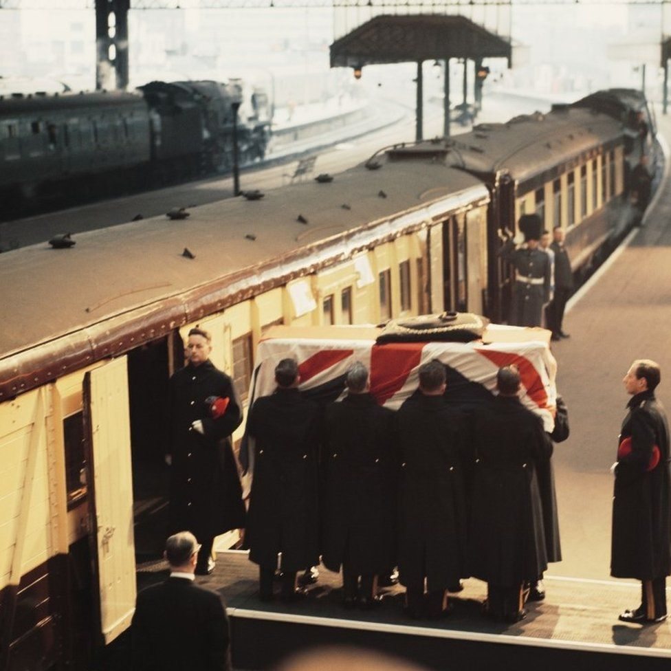 Churchill's coffin loaded onto a train at Waterloo Station, before travelling to Oxfordshire