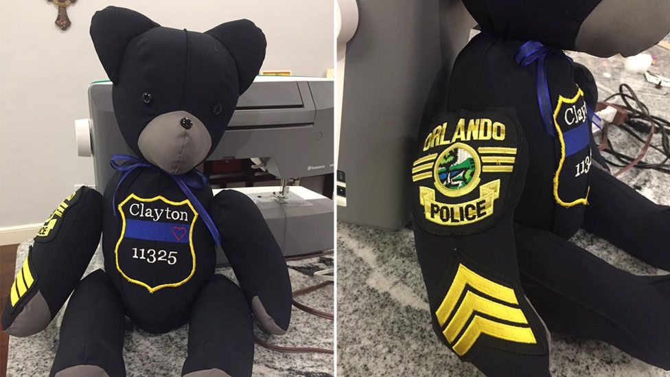 Composite image showing a completed bear from the front, with the officer's badges and stripes of office on the side