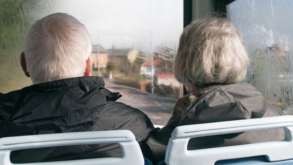 Old couple on bus