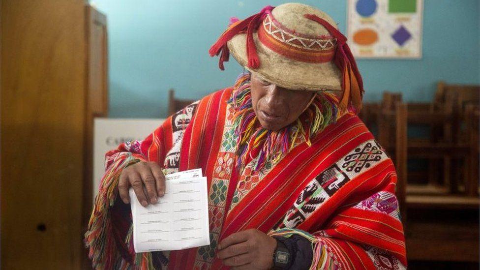 A man casts his vote in Cuzco. Peru.