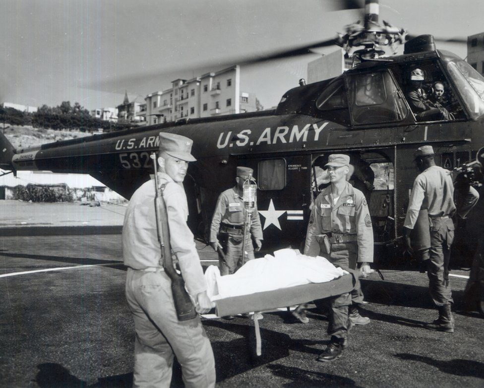 """""""Patient with polio is carried to ambulance"""" c. 1950s (SC 539538) OHA 343: US Army Signal Corps Photograph Collection. Otis Historical Archives. National Museum of Health and Medicine."""
