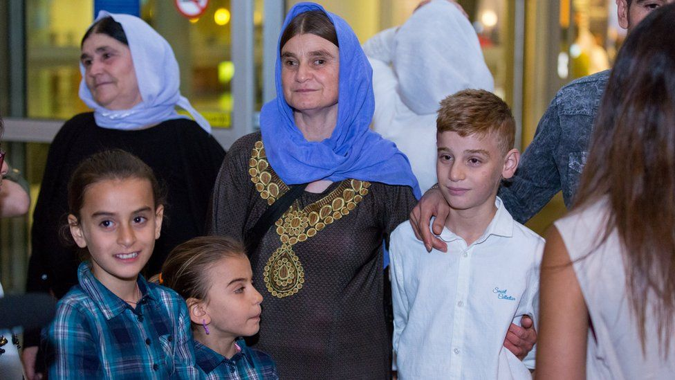 Imad Mishko Tammo, in white, twelve-year-old Yazidi boy, is reunited with his mother.
