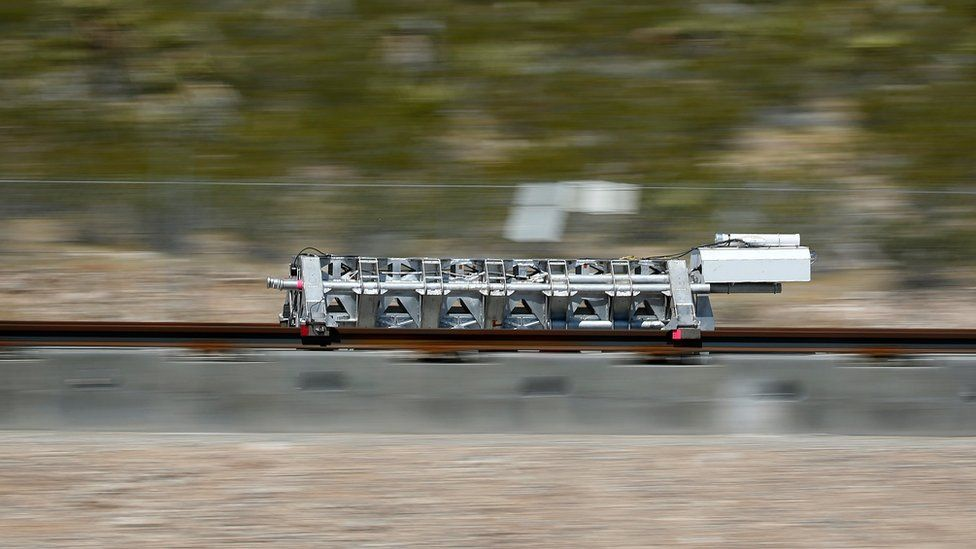 A sled speeds down a track during a test of a Hyperloop One propulsion system, Wednesday,