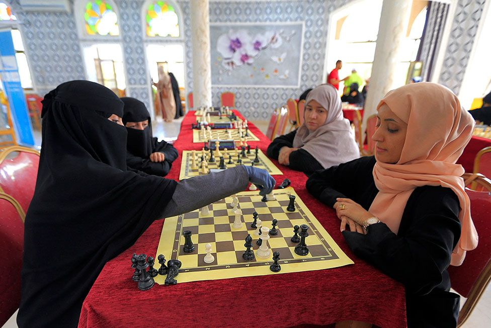 Women playing chess