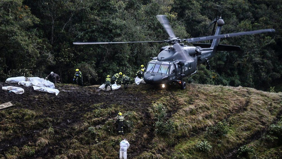 Rescue teams recover the bodies of victims of the LAMIA airlines charter that crashed in the mountains of Cerro Gordo, municipality of La Union, Colombia, on November 29, 2016
