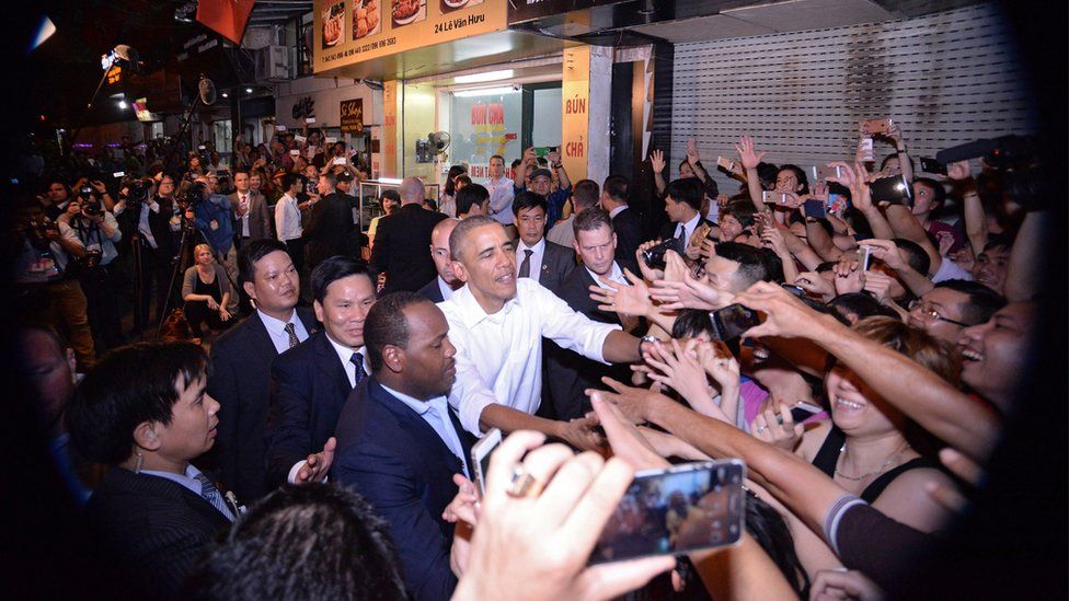 President Obama shakes hands with locals as he leaves the restaurant