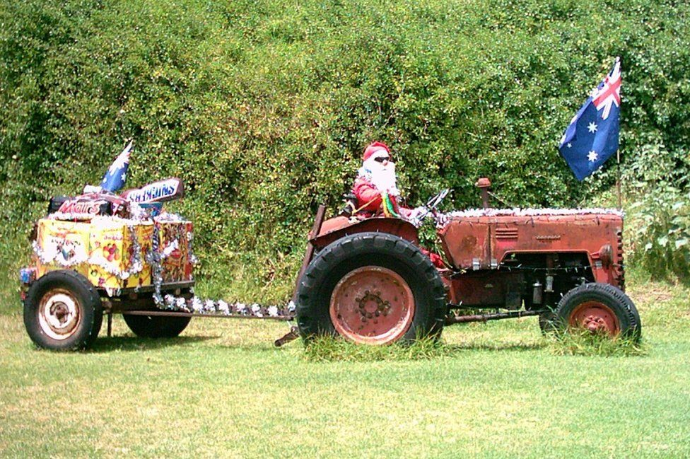 Father Christmas on a tractor