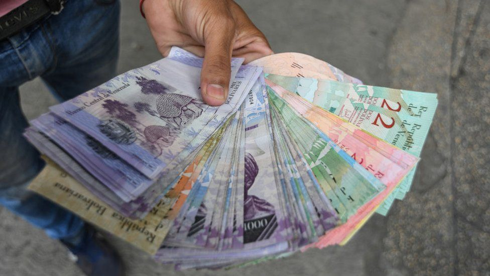 A man seen holding Venezuelan bank notes